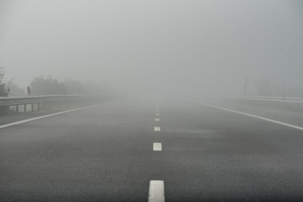 Foggy highway empty road